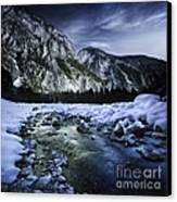 A River Flowing Through The Snowy Canvas Print
