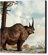 A Woolly Rhinoceros Trudges Canvas Print by Daniel Eskridge
