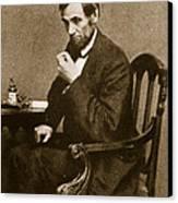 Abraham Lincoln Sitting At Desk Canvas Print by Mathew Brady