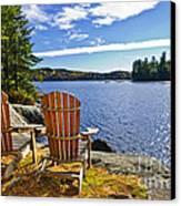 Adirondack Chairs At Lake Shore Canvas Print