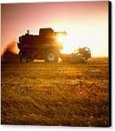 Agriculture - A Combine Harvests Wheat Canvas Print by Mirek Weichsel