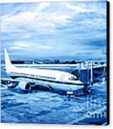 Airplane At Aerobridge Canvas Print by William Voon