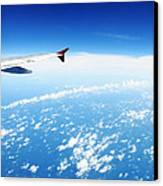 Airplane Wing Against Blue Sky Horizon Canvas Print by William Voon