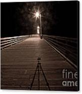 Alone On The Pier Canvas Print by Ron Hoggard