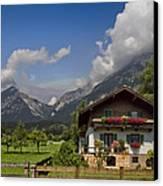 Austrian Cottage Canvas Print by Debra and Dave Vanderlaan