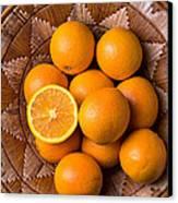 Basket Full Of Oranges Canvas Print