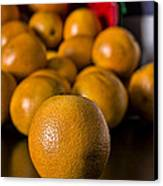 Basket Of Oranges Canvas Print by Jeff Burton
