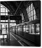 Berlin S-bahn Train Speeds Past Platform At Alexanderplatz Main Train Station Germany Canvas Print by Joe Fox