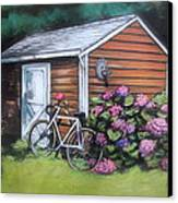 Bicycle Resting On Shed Canvas Print by Melinda Saminski