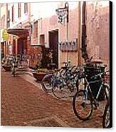 Bikes In Alley Canvas Print by Emily Clingman
