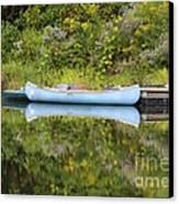 Blue Canoe Canvas Print by Deborah Benoit