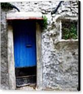 Blue Door  On Rustic House Canvas Print