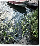 Boat At Dock On Lake Canvas Print