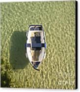 Boat On Ocean Canvas Print by Pixel Chimp