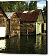 Boathouses On The River Canvas Print by Michelle Calkins