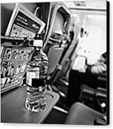 Bottle Of Water On Tray Table Interior Of Jet2 Aircraft Passenger Cabin In Flight Canvas Print by Joe Fox