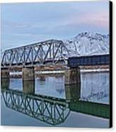 Bridge Over Tranquil Waters In Kamloops British Columbia Canvas Print by Steve Boyko