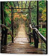Bridge Over Waterfall Canvas Print by Nawarat Namphon