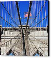 Brooklyn Bridge With American Flag Canvas Print by Nishanth Gopinathan