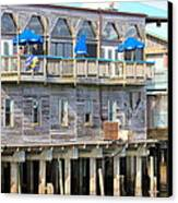 Building On Piles Above Water Canvas Print by Lorna Maza