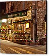 Cafe In Assisi At Night Canvas Print by Susan Schmitz