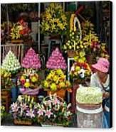 Cambodia Flower Seller Canvas Print by Mark Llewellyn