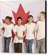 Children In Front Of Canadian Flag Canvas Print by Don Hammond