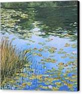 Clouds In The Pond Canvas Print by Anna Lowther