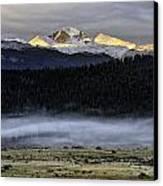 Clouds Over Longs Peak Canvas Print by Tom Wilbert