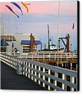 Colorful Flags And Wharf Canvas Print by Debra Thompson