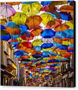 Colorful Floating Umbrellas Canvas Print by Marco Oliveira