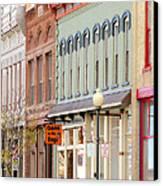 Colorful Shops Quaint Street Scene Canvas Print by Ann Powell