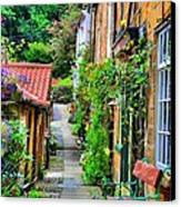 Cottage Row Canvas Print by Dave Woodbridge
