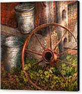 Country - Some Dented Pails And An Old Wheel  Canvas Print