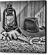 Cowboy Hat And Rodeo Lasso In A Black And White Canvas Print by Paul Ward