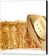 Cowboy Hat On Straw Bale Canvas Print by Olivier Le Queinec