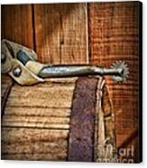 Cowboy Themed Wood Barrel And Spur Canvas Print by Paul Ward