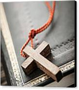 Cross On Bible Canvas Print