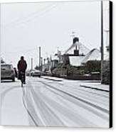 Cyclist In The Snow Canvas Print by Tom Gowanlock