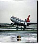 Douglas Dc-10-40 Taking Off In The Rain Canvas Print by Wernher Krutein