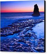 Dramatic Sunset View Of A Sea Stack In Davenport Beach Santa Cruz. Canvas Print by Jamie Pham