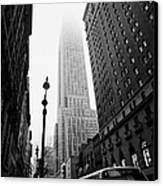 Empire State Building Shrouded In Mist And Nyc Bus Taken From 34th And Broadway Nyc New York City Canvas Print by Joe Fox
