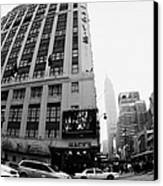 Empire State Building Shrouded In Mist As Yellow Cabs Crossing Crosswalk On 7th Ave And 34th Street Canvas Print by Joe Fox