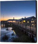 Evening Sky At The Dock Canvas Print by Debra and Dave Vanderlaan