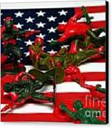 Fallen Toy Soliders On American Flag Canvas Print by Amy Cicconi
