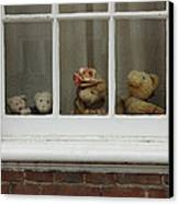 Family Of Teddy Bears On The Window. Canvas Print