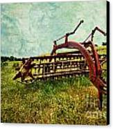 Farm Equipment In A Field Canvas Print by Amy Cicconi