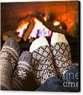 Feet Warming By Fireplace Canvas Print