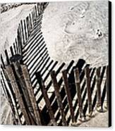 Fence Shadows Canvas Print by John Rizzuto