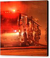Firemen At Work Canvas Print by Donald Torgerson